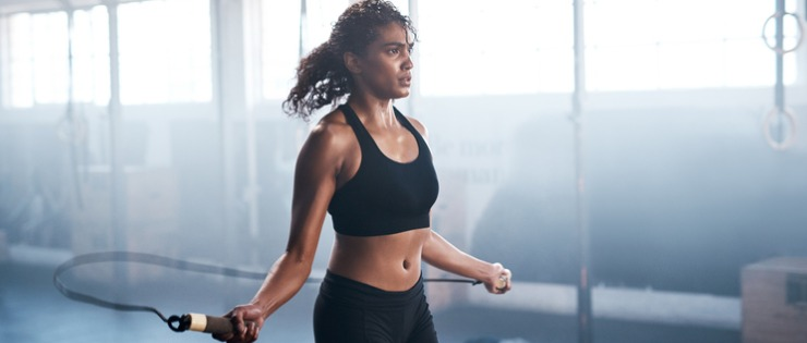 Fit female sweating at the gym to control the body's core temperature