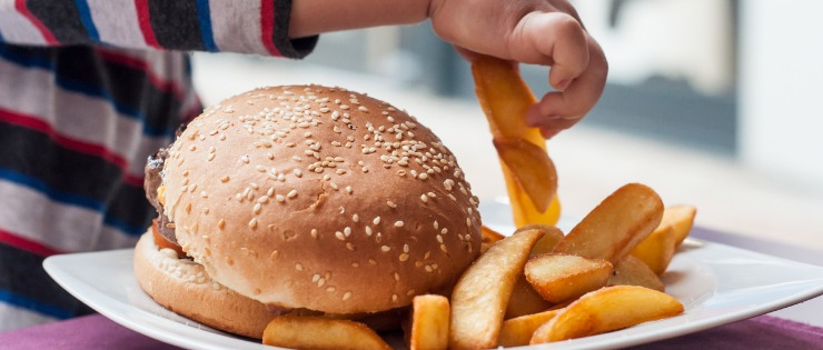 Fast food with large amounts of saturated fat