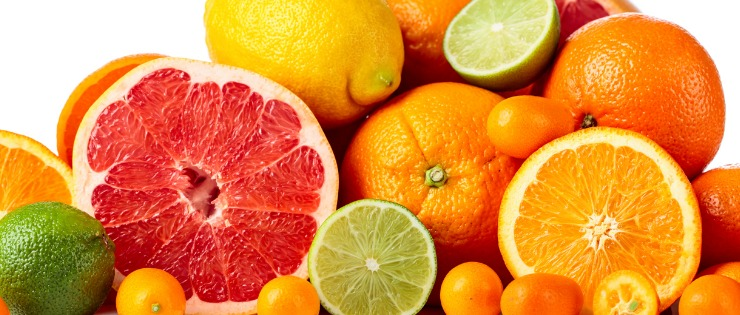 a pile of fresh citrus fruit. Citrus fruits could help care for both cold and hay fever symptoms