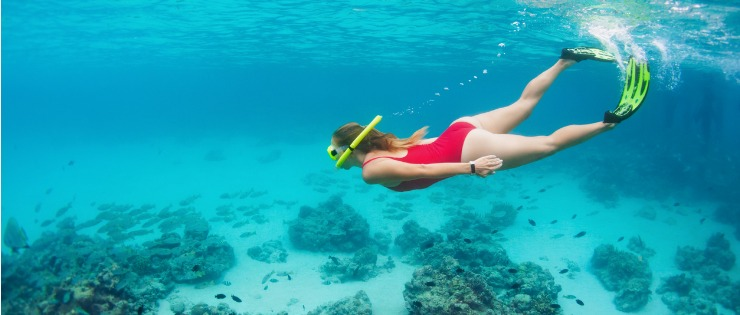 Young female snorkelling under water on Rottnest Island