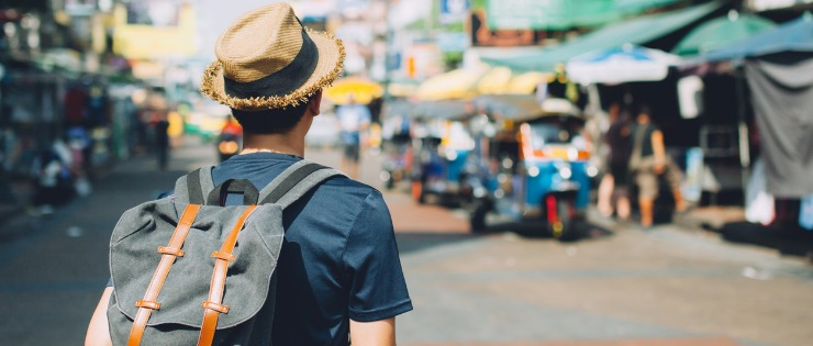 Young man traveling with a backpack on