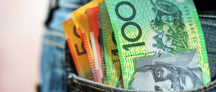 A jeans pocket full of Australian banknotes - transferring your money from Canada to Australia can be expensive