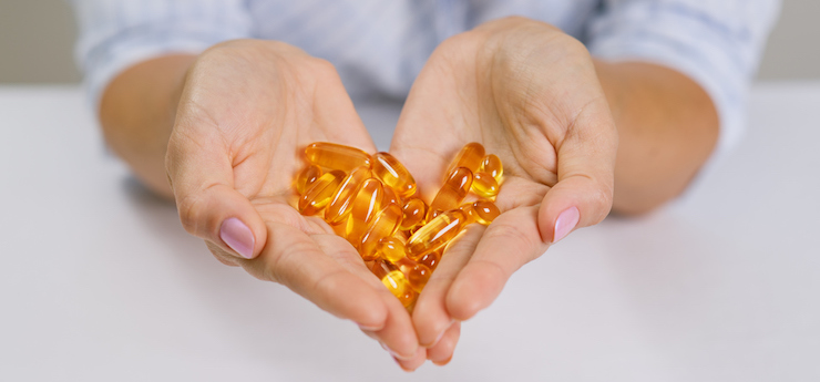 A handful of fish oil supplements taken because of the health benefits of fish oil