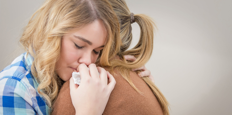 friends supporting and comforting one another after a miscarriage