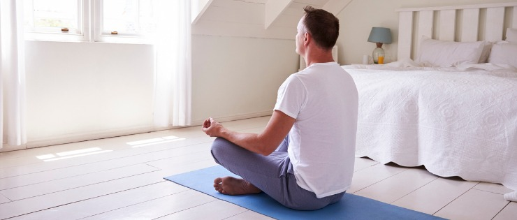 A man meditating to reduce stress and maintain good digestive health